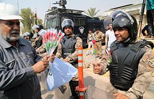 صورة تظاهرات البصرة تصوير احسان ناجي الديوان