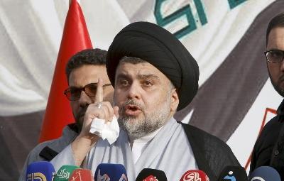 صورة لاول مرة زعيم عراقي يدعو الاسد الى الاستقالة ويطالب امريكا بكف اذاها