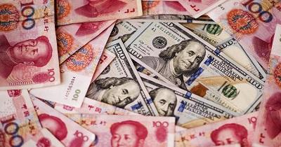 صورة الصين تخفض عملتها مقابل الدولار الامريكي