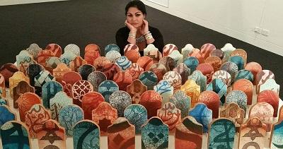 صورة الفنانة المغربية فاطمة كليين : أعمالي الفنية فيها رائحة الوطن الام وانكسار المهاجرين