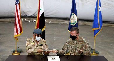 صورة قوات التحالف الدولي تنسحب من قاعدة التاجي وتسلمها للقوات العراقية