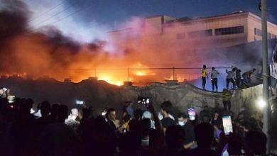 صورة في الناصرية..أجسادٌ ممزقة تحترق